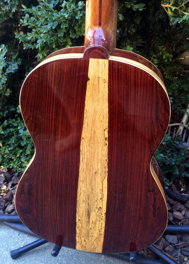 All hand made solid wood guitar back.